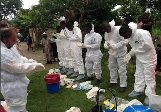 WHO crew preparing to handle dead bodies of those who died from Ebola
